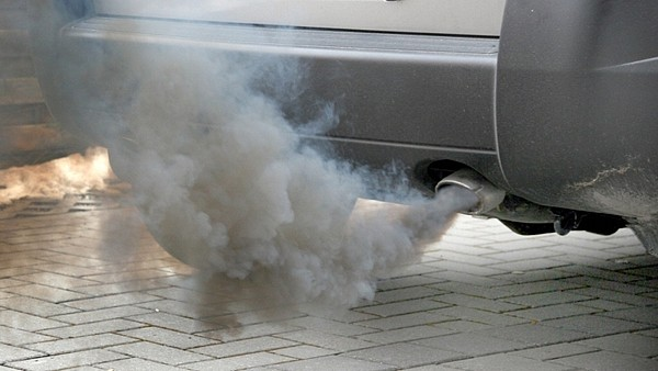 car emitting hazardous pollutants to atmoshphere